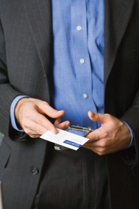 Businessman taking business card from his wallet