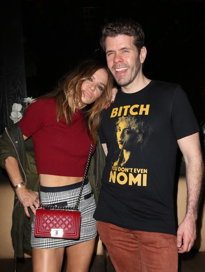 Perez Hilton catches up with actress Robin Antin at his 38th birthday bash. Photo Credit : Faye Sadou.