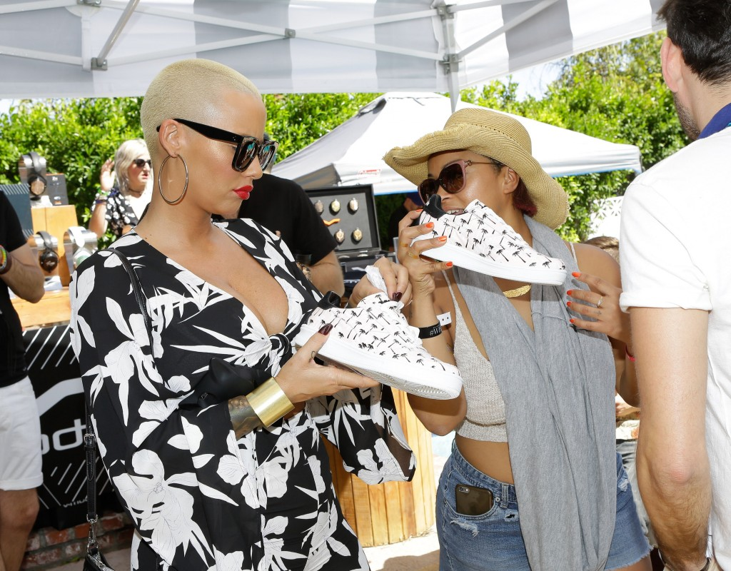 Model Amber Rose checks out Diadora shoes at The Music Loung, presented by the Vegas and #WHHSH. Photo Credit: Tiffany Rose/Getty Images for Kendallbrent, Inc.