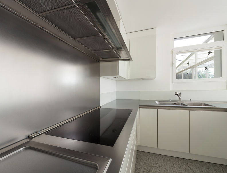 46190140 - modern house, stove top of a domestic kitchen