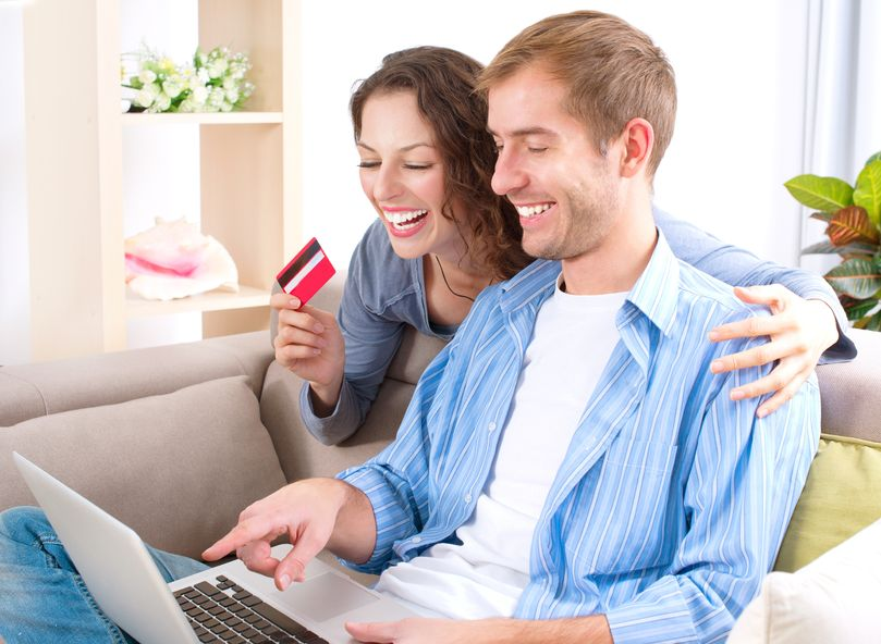16472458 - young couple with laptop and credit card buying online