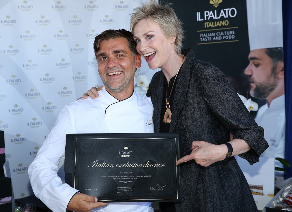 Actress Jane Lynch checks out Chef Filippo Sinisgalli at the PILOT PEN & GBK Pre-Emmy Luxury Lounge. Photo Credit: Maury Phillips/Getty Images for GBK Productions.