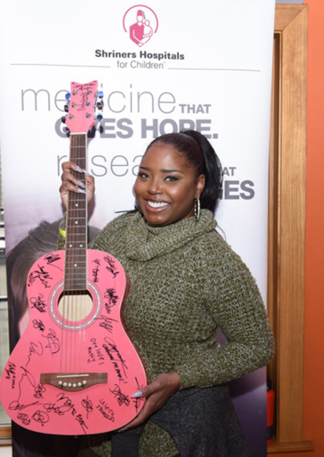 Shar Jackson showed off her pearly whites at Debbie Durkin's 10th Annual EcoLuxe Lounge during the Sundance Film Festival. Photo Credit: Vivien + Paul Best from Getty Images.