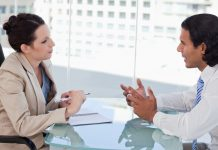 Young businesspeople negotiating in a meeting room