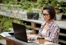 Woman working on computer outdoors