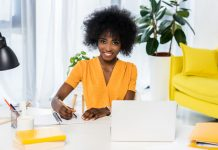 Cheerful woman working in her office