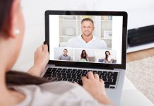 Young woman using laptop for video conference at home