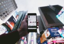 Instagram on mobile phone against Times Square background