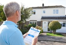 Man assessing a house